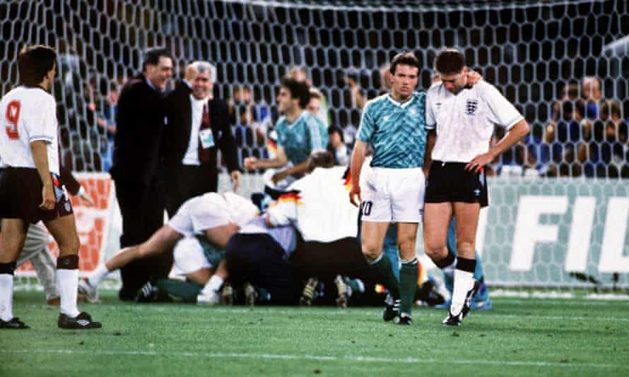 The West Germany captain Lothar Matthäus consoles England's Chris Waddle after the penalty shootout in the World Cup semi-final at Italia 90.