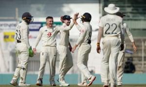England celebrate the wicket of Pujara.