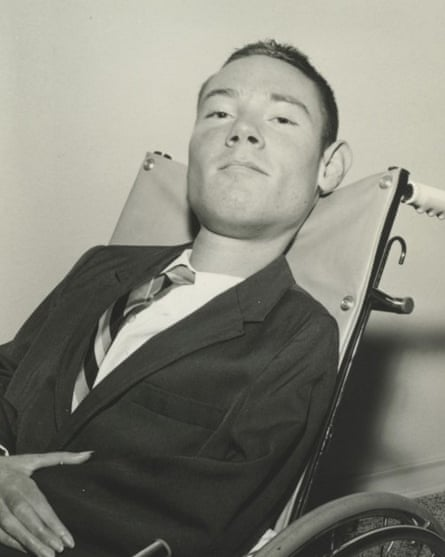 Paul Alexander, who was paralysed by polio in 1952, in a wheelchair while taking a break outside his iron lung, circa 1960s
