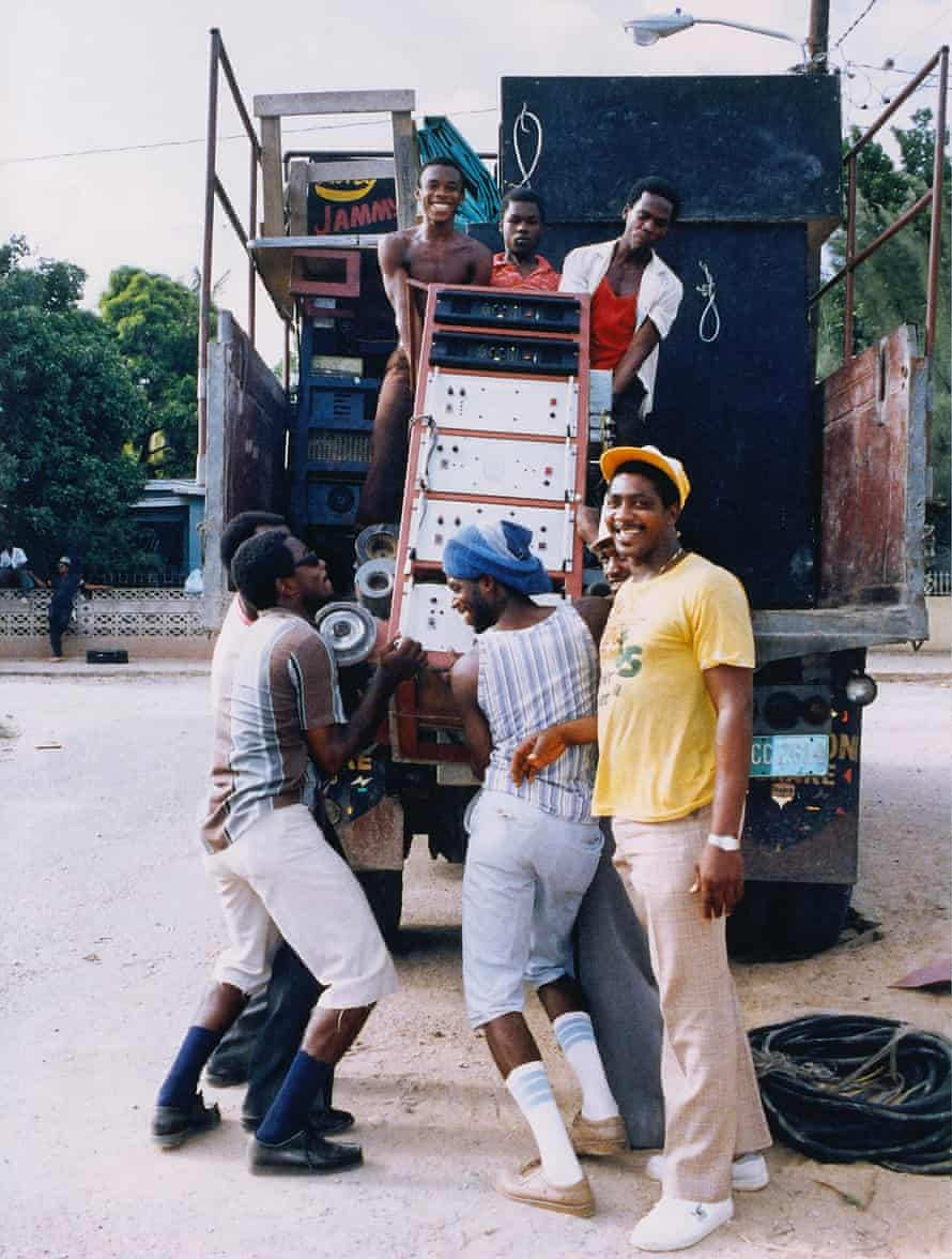 King Jammy's soundsystem is loaded on to a truck by young men wearing Clarks.