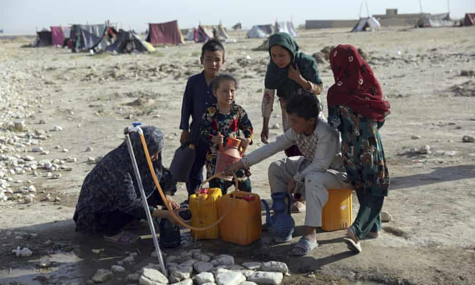 Internally displaced Afghans fleeing fighting between the Taliban and Afghan security forces at a camp near Mazar-e-Sharif, Afghanistan, July 2021