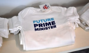 Baby T-shirts are displayed for sale at the 2016 Conservative party conference.