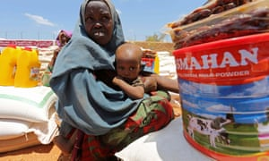 An internally displaced Somali woman receives food aid at a distribution centre in Baidoa, west of the capital, Mogadishu.