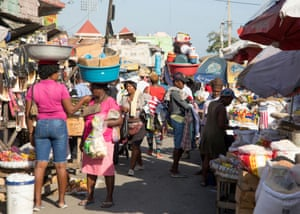 People walk in a market as they go about their lives in Port-au-Prince, Haiti, in a file photo taken May 24.