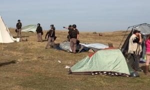 Law enforcement officers move in on the camp during the Dakota Access pipeline protest