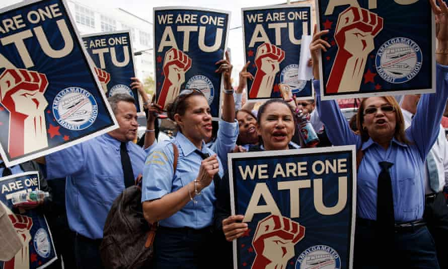 Members of the Amalgamated Transit Union protest in support of Uber and Lyft drivers in New York on 27 September 2016.