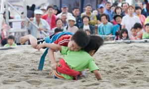 Children take part in ssireum, traditional Korean wrestling