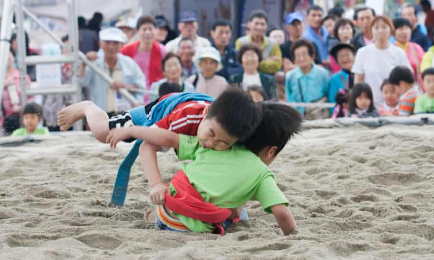 Children take part in ssireum, traditional Korean wrestling