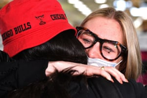 AUSTRALIA-NZEALAND-HEALTH-VIRUSA mother hugs her daughter (L) upon her arrival from New Zealand at Sydney International Airport on April 19, 2021, as Australia and New Zealand opened a trans-Tasman quarantine-free travel bubble. (Photo by SAEED KHAN / AFP) (Photo by SAEED KHAN/AFP via Getty Images)