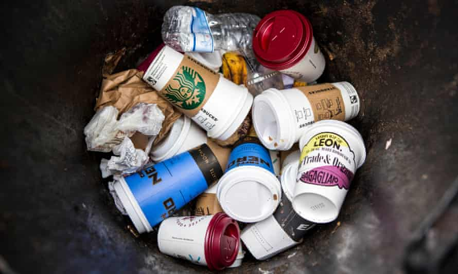 Coffee cups in a street rubbish bin in central London