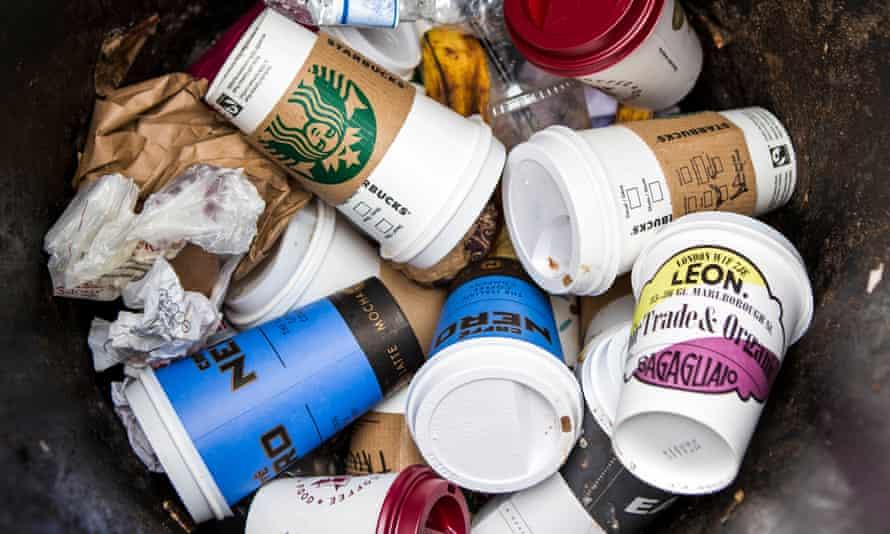 Coffee cups in a street bin