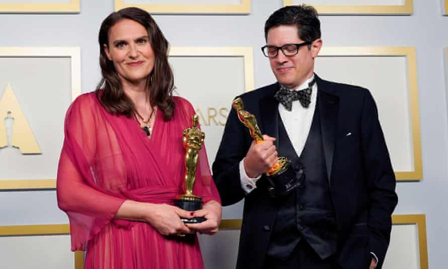 Alice Doyard and Anthony Giacchino pose with the Oscar in the press room.
