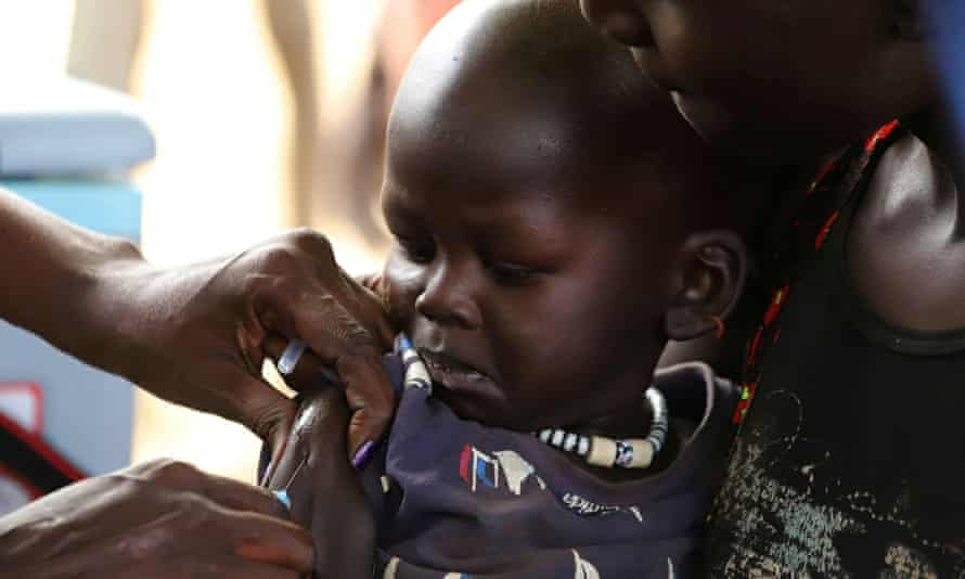 A child is vaccinated against measles in Juba, South Sudan