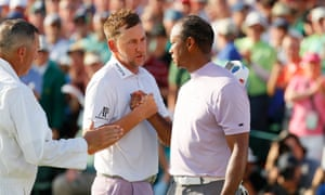Ian Poulter and Tiger Woods shake hands after the pair finished their rounds at Augusta.