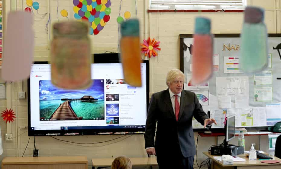 Boris Johnson joins a physically distanced lesson at Bovingdon primary academy in Hertfordshire