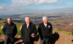 The Israeli prime minister, Benjamin Netanyahu, centre, visits the Golan Heights with Senator Lindsey Graham, left, and the US ambassador to Israel, David Friedman.