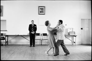 Dancing-master Ted van Rensburg watches two of his ballroom pupils swinging to Victor Sylvester and his Orchestra at the old Court House, Boksburg, 1980.