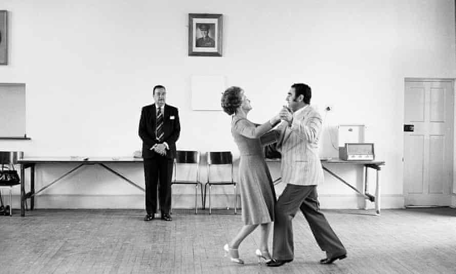 David Goldblatt's 1980 photograph of ballroom dancers in the court house of the town of Boksburg; the dancing-master Ted van Rensburg looks on