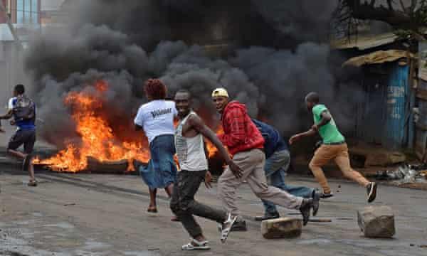 Protestors run from police in Kibera slum, Nairobi, during a 2016 demonstration