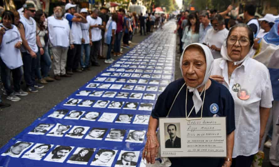 Grandmothers of Plaza de Mayo and other demonstrators in Buenos Aires display portraits of Argentinians who disappeared under the military regime. Now DNA tests are being used to help identify the remains of the victims.