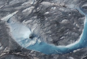 Large rivers of meltwater drain into moulin holes that empty into the ocean from underneath the ice