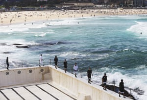 Models showcase designs during the Ten Pieces show at Bondi Icebergs, overlooking Bondi beach, during Fashion Week on 16 April.