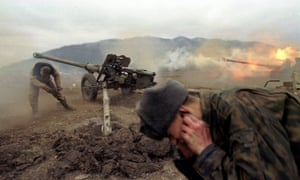 Russian soldiers fire at rebel positions near the village of Duba-Yurt, during the second Chechen war in 2000.
