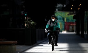 UK Remains On Lockdown Due To Coronavirus As Infection Rate Appears To SlowLONDON, ENGLAND - APRIL 07: A Deliveroo cyclist wearing a mask makes his way through the Westfield Stratford Shopping Centre on April 07, 2020 in London, England. There have been around 50,000 reported cases of the COVID-19 coronavirus in the United Kingdom and 5,000 deaths. The country is in its third week of lockdown measures aimed at slowing the spread of the virus. (Photo by Alex Pantling/Getty Images)