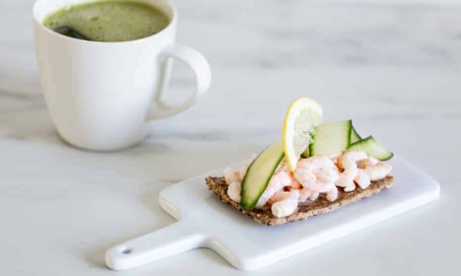 A shrimp and cucumber open sandwich.