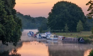 Boats in the dawn mist upriver at Abingdon-on-Thames, part of the stretch where Three Men in a Boat is set.