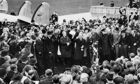 Neville Chamberlain holding aloft the Anglo-German Declaration to a cheering crowd at Heston Airport, 30 September 1938.