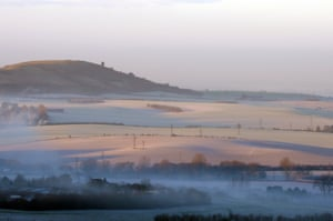 Fog hangs across Aylesbury Vale from Dunstable Downs as the sun breaks through the valley