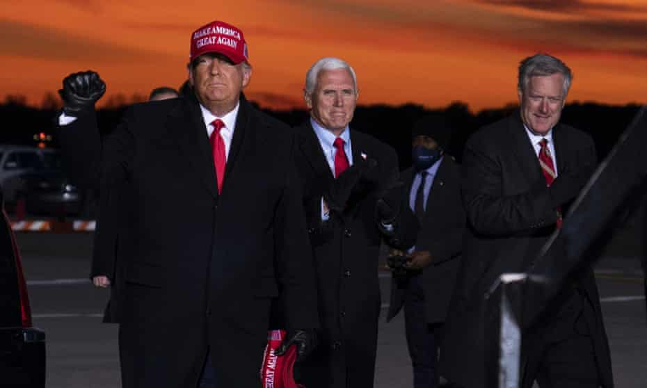 Mark Meadows, the former White House chief of staff, with Donald Trump and Mike Pence in Traverse City, Michigan in November last year.