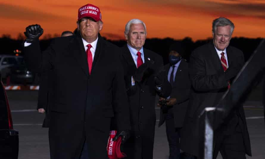 Mark Meadows, the former White House chief of staff, with Donald Trump and Mike Pence in Traverse City, Michigan in November last year. Meadows is of special interest to the select committee.