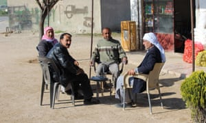 Villagers outside a local shop in northern Syria