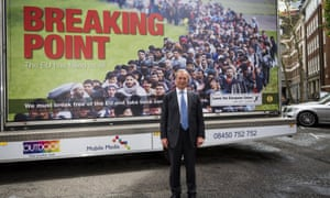 Nigel Farage stands in front of the much-criticised 'Breaking point' poster used during the EU referendum campaign.