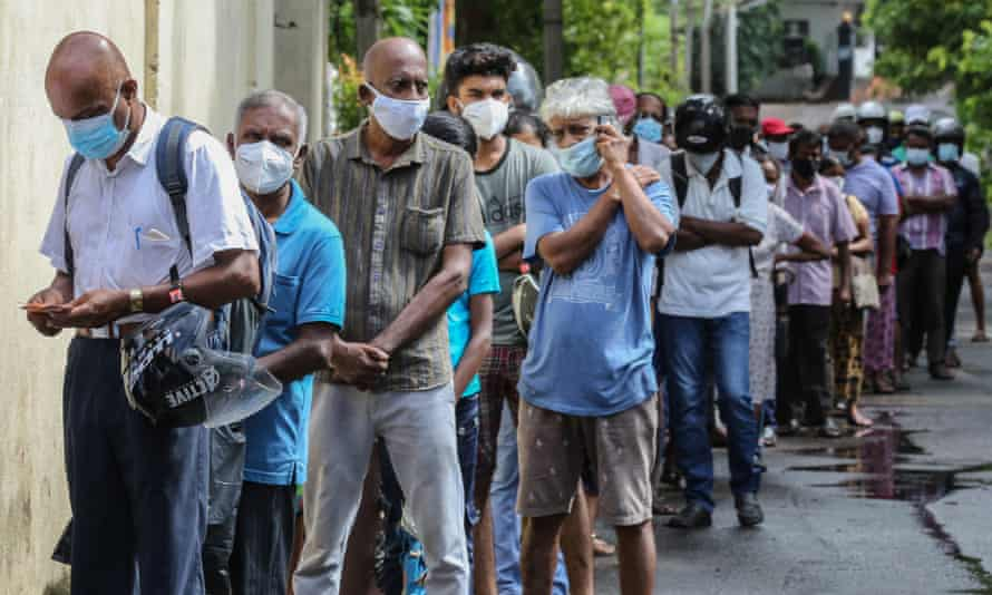 The Covid-19 pandemic led to a shortage of essential foods in Sri Lanka. People formed long lines to buy food at a state-run store in Colombo.