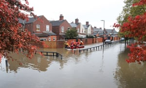 The Fire and Rescue Services evacuate a disabled man from his home during the flooding in the Bentley area of Doncaster