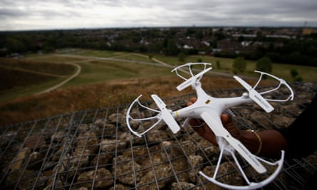 An activist holds a drone near Heathrow airport in London.