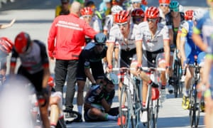 Mark Cavendish awaits assistance by medics after the crash on the finish to stage four.