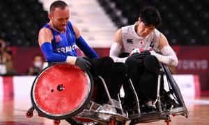 Masayuki Haga of Japan is tackled by Jonathan Hivernat of France.