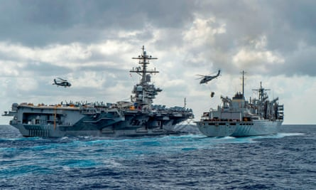 The USS Abraham Lincoln aircraft carrier receives supplies at sea