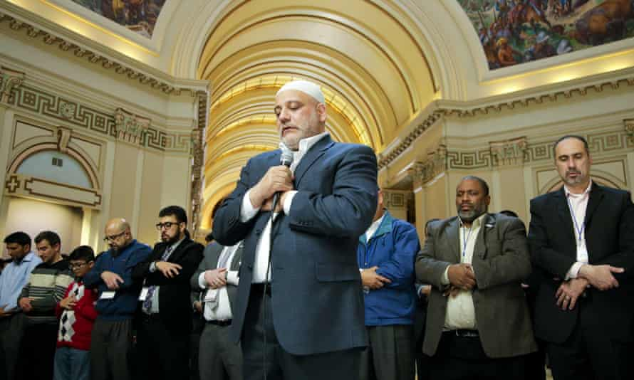 Imad Enchassi, center, leads a group of Muslims at the Oklahoma state capitol in prayer on Thursday.