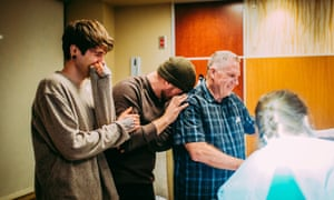 Elliott Dougherty and Matthew Eledge look on, along with Matthew's father Kirk Eledge, after the birth.