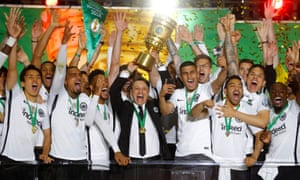 Departing manager Niko Kovac is surrounded by his Eintracht Frankfurt players as they celebrate defeating Bayern Munich 3-1 in the DFB-Pokal final in Berlin.
