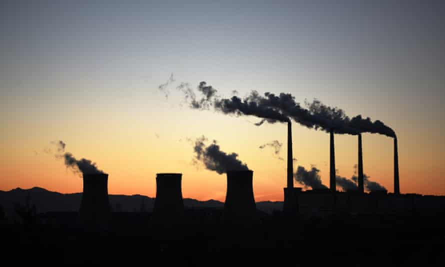 Fumes escaping from chimneys and cooling towers at a coal power plant in China.