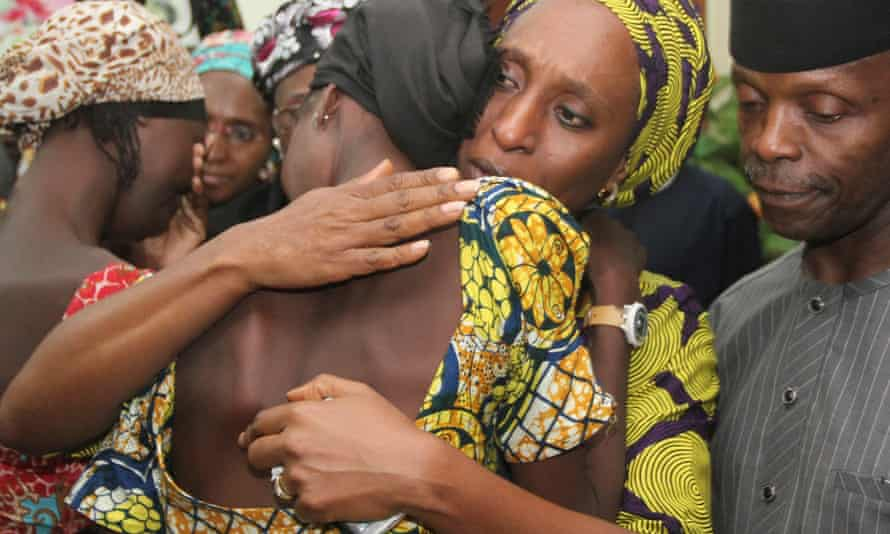 Nigerian Vice President Yemi Osinbajo, right, watches as his wife Dolapo comforts one of 21 Chibok girls released by Boko Haram in 2016.