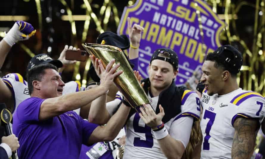 Ed Orgeron, left, Joe Burrow and Grant Delpit, right, celebrate LSU's title win