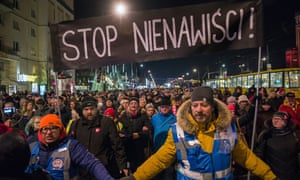 Demonstrators holding a 'stop the hate' during a march in memory of Paweł Adamowicz