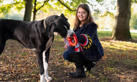 Teen entrepreneur Olivia Bassett with her dog Bebe and the pet toys she makes